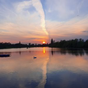 Sunset across Danson Park Lake
